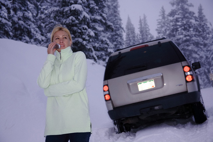 Woman Stranded in Snow Using Cell Phone
